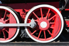 Closeup view of a mechanical equipment around a steam locomotive Royalty Free Stock Photo