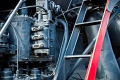 Closeup view of a mechanical equipment around a steam locomotive Royalty Free Stock Photos