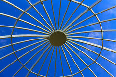 Closeup view of metal structure dome with clear glass roof and blue sky Royalty Free Stock Images