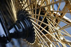 Motorcycle wheel with gold spokes Stock Image