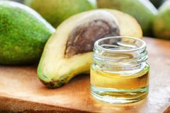 Closeup view of natural avocado oil on wooden board stock photography