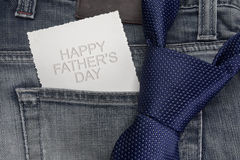 Closeup view of a necktie on jeans trousers. With greeting card. Happy father's day Royalty Free Stock Photography