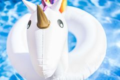 Free Closeup View Of Inflatable Colorful White Unicorn At The Swimming Pool. Fun Time In The Summer At Swimming Pool. Concept. Stock Photography - 118063382
