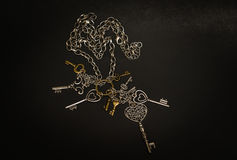 Closeup view of old decorative various vintage keys on dark grey Stock Photo