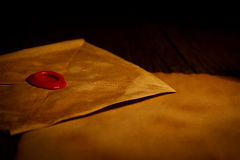 Closeup view of old envelope with wax seal stamp Royalty Free Stock Image