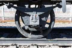 Closeup view of an old railway car wheels, leaf springs, journal Royalty Free Stock Images