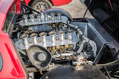 closeup view of old vintage sport car engine Stock Photos