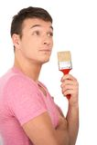 Closeup view of painter holding paintbrush. Royalty Free Stock Photos