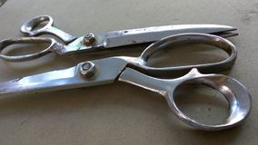 Pair of tailor scissors. A closeup view of pair of stainless steel scissors which is used by tailors for cutting the cloth royalty free stock photos