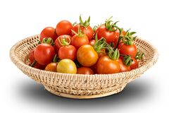 Free Closeup View Pile Of Freshly Harvested Ripe And Juicy Tomatoes In Bamboo Basket Isolated On White Background With Clipping Path Royalty Free Stock Photography - 213211857