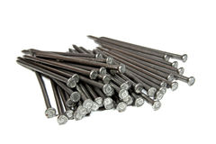 Closeup View of Piled Wire Nails on White Royalty Free Stock Photography