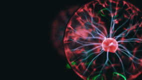 Closeup view of plasma ball with moving energy rays inside on black background stock video footage