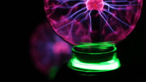 Closeup view of plasma ball with moving energy rays inside on black background stock video