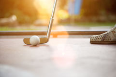 Closeup view from a professional minigolf player with lens flare Royalty Free Stock Photography