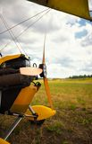Closeup view on propeller yellow ultralight trike is parked on the earth Royalty Free Stock Photos
