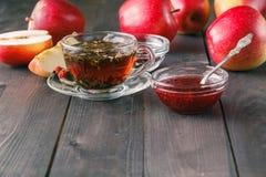 Closeup view of raspberry jam and herbal tea Stock Photos