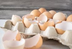 Closeup view of raw chicken eggs in an egg box stock image