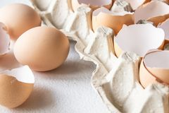 Closeup view of raw chicken eggs in an egg box royalty free stock images