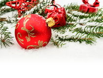 Closeup view of red christmas bauble with gifts Royalty Free Stock Images