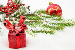 Closeup view of red christmas bauble with gifts Royalty Free Stock Photo