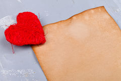 Closeup view of red heart on rustic paper Stock Photos