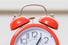Closeup view on red retro alarm clock stock image