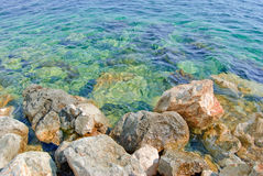 Closeup view of a rocky coast of the mediterranean sea Royalty Free Stock Images