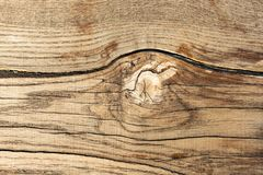Wooden texture with a snag stock image