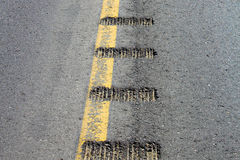 Closeup view of rumble strips on a road Royalty Free Stock Images