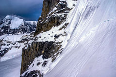 Dramatic View of Snowy Sheer Mountain Cliff in Alaska. Stock Images