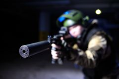 Closeup view on silencer on mashine gun in military hands Stock Photography