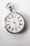 Closeup view of a silver pocket watch. Royalty Free Stock Images