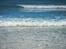 Closeup view of soft sea wave of blue ocean approaching to the b. Closeup view of sea wave of ocean approaching to the beach Stock Photos