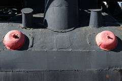 Closeup view of some metallic details of an old steam locomotive Royalty Free Stock Images