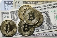 Bitcoin closeup on US currency Stock Photo