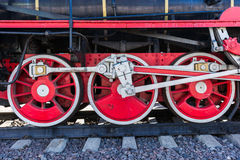 Closeup view of steam locomotive wheels, drives, rods, links and Stock Photos