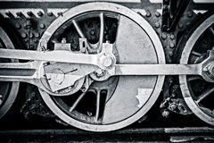 Closeup view of steam locomotive wheels, drives, rods, links and. Other mechanical details. White, black and red colors. Black and white photography Royalty Free Stock Photo