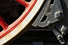 Closeup view of steam locomotive wheels, drives, rods, links and. Other mechanical details. White, black and red colors. Brakes system Royalty Free Stock Photography