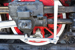 Closeup view of steam locomotive wheels, drives, rods, links and. Other mechanical details. White, black and red colors. Gear motion Royalty Free Stock Photo
