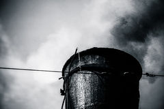 Closeup view of the steam train chimney. Black smoke comes out o Stock Photography