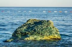 Closeup view on stone and sea Stock Photos