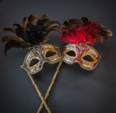 Closeup view of theatrical old colorful masks on dark grey background Royalty Free Stock Image