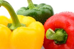 Closeup view of three coloured pepper isolated white Stock Photos