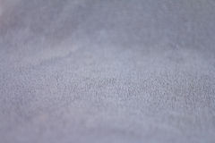 Closeup view of towel. Closeup view of blue towel. Fluffy gray background Stock Images