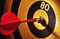 Toy Darts and Target. Closeup view on toy darts and yellow-black target Royalty Free Stock Photos