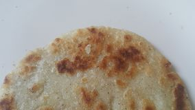 Closeup view of of traditional home made bread called Jawar roti or bhakri. Closeup view of of traditional bread called Jawar roti or bhakri on white background royalty free stock image