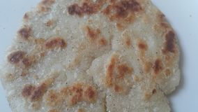 Closeup view of of traditional home made bread called Jawar roti or bhakri. Closeup view of of traditional bread called Jawar roti or bhakri on white background stock photography