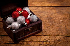 Closeup view of treasure box with Christmas globes Royalty Free Stock Images