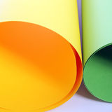 Rolls of colourful cardboard. Closeup view of two rolls of colourful cardboard in orange and green for creating posters or artwork lying side by side stock photo