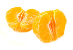 Closeup view of two unpeeled tangerine halves Royalty Free Stock Images
